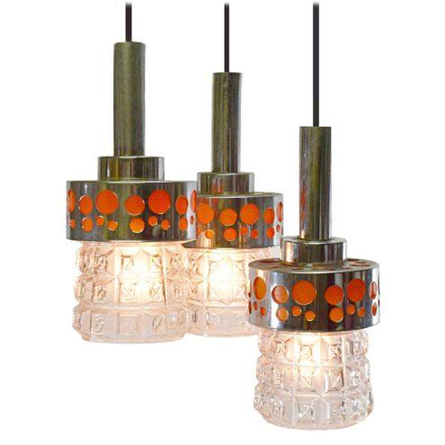 Massive Belgium triple pendant lamp chrome & orange circles pressed glass lampshades 1960s 1970s Raak The Netherlands