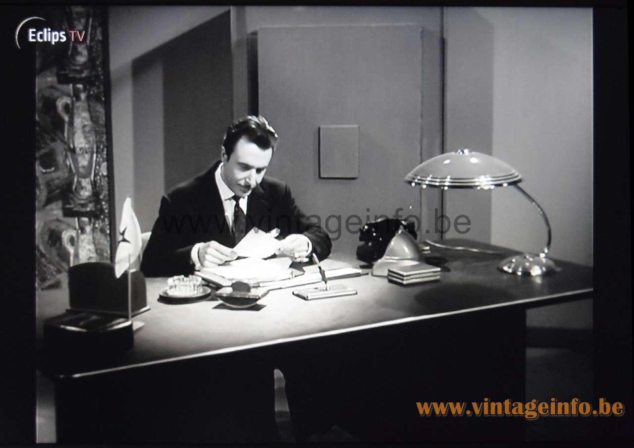 Helo Leuchten Desk Lamp used as a prop in the film Het Geluk Komt Morgen (1958)