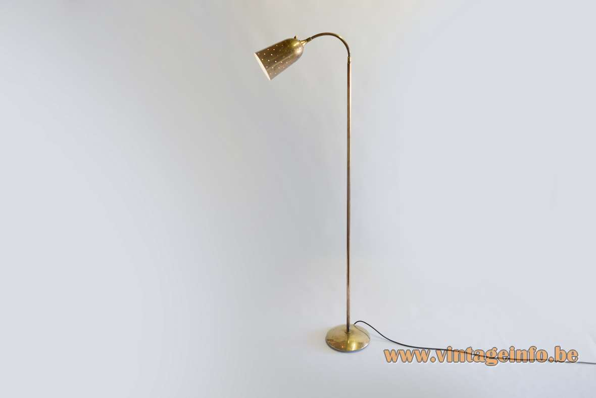 Paavo Tynell brass floor lamp round base long rod perforated conical lampshade Taito Idman Finland 1950s