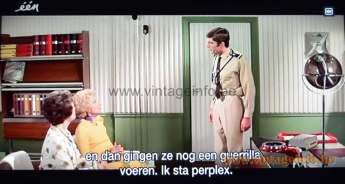Raak Globe floor lamp used as a prop in the comedy film Le Gendarme En Balade (1970)