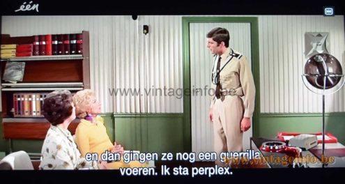 Raak Globe floor lamp used as a prop in the comedy film Le Gendarme En Balade (1970)
