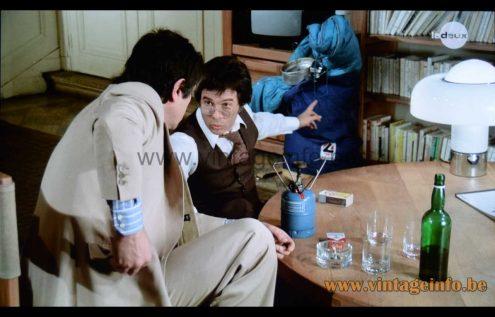 White Harvey Guzzini Brumbry table lamp used as a prop in the 1976 film Un Éléphant Ça Trompe Énormément