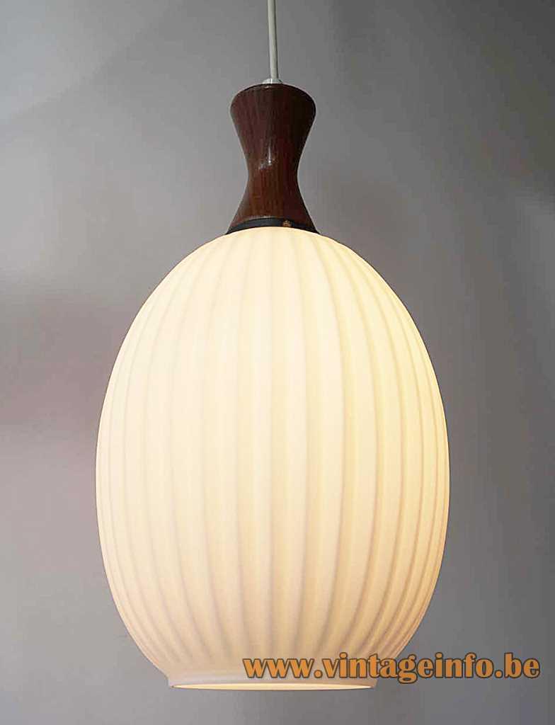 Massive ribbed glass pendant lamp Louis Kalff opal oval lampshade concave dark wood top 1960s Belgium
