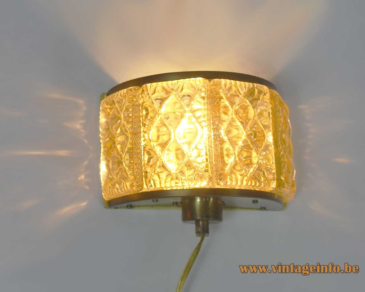 Vitrika amber glass wall lamp embossed half round curved glass brass parts E27 socket 1970s Denmark