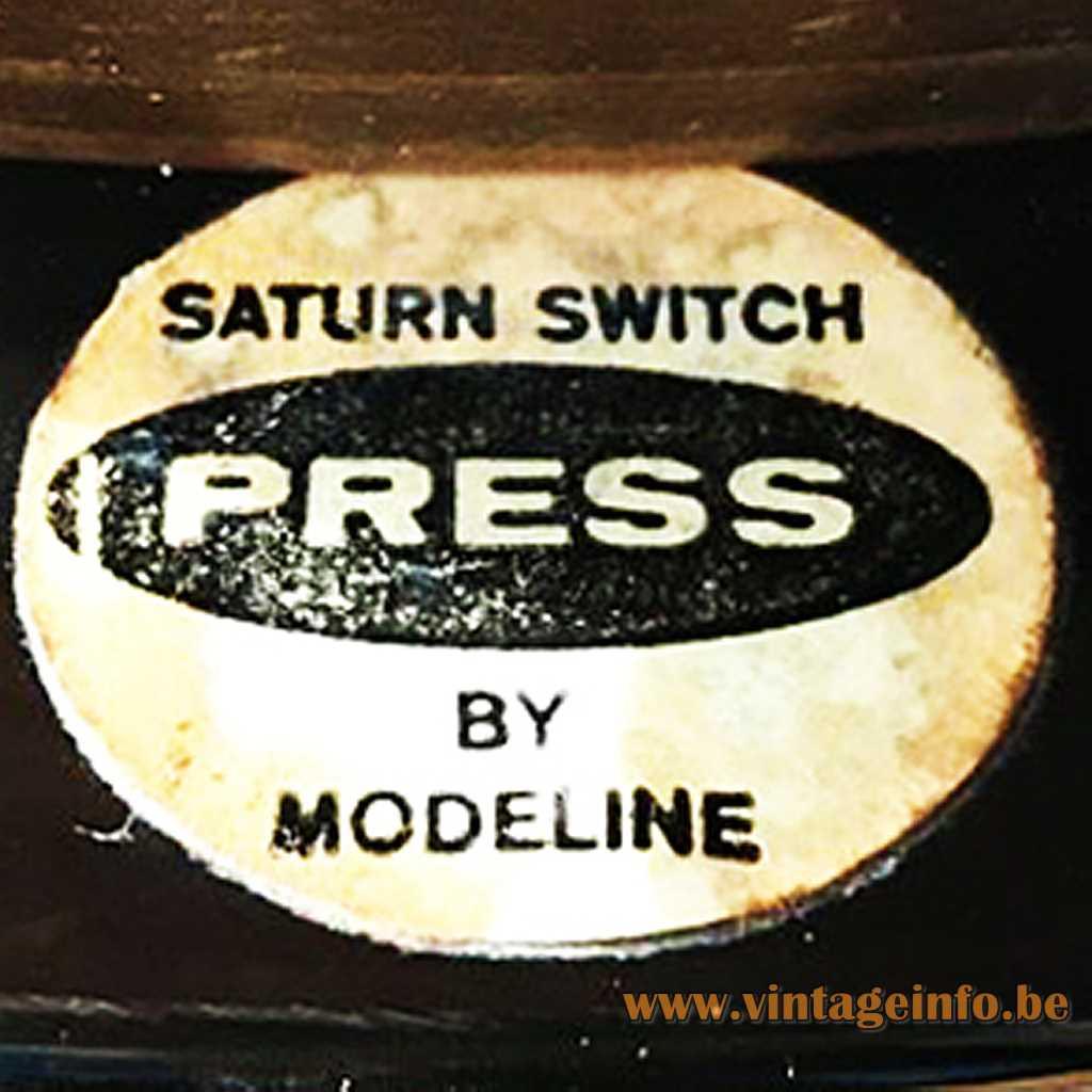 Saturn switch Press Modeline label