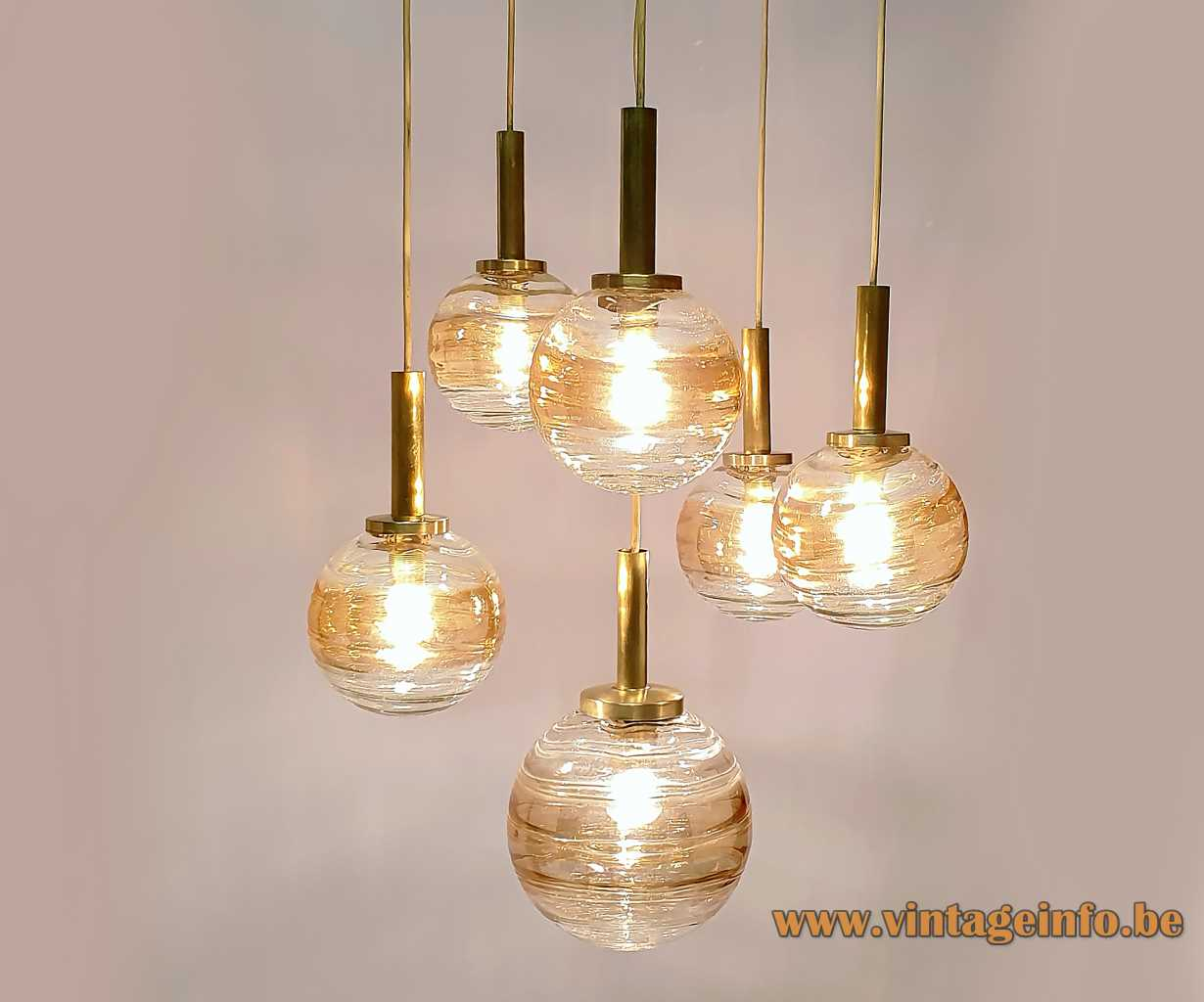 Wortmann globe pendant chandelier with six cascade hanging amber and clear glass lamps 1960s WOFI Leuchten