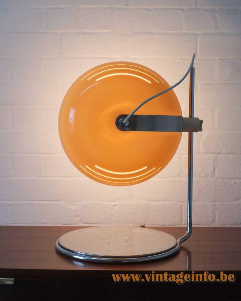 1960s Harvey Guzzini table lamp design: Luigi Massoni round chrome base yellow-brown acrylic lampshade 1970s Italy