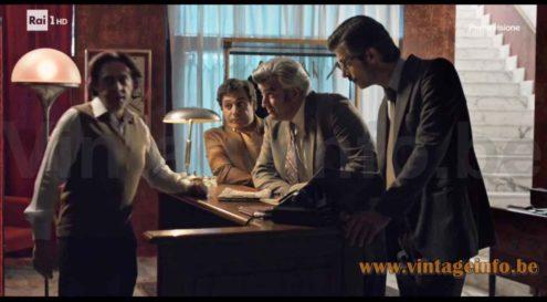 Reggiani half globe floor lamp used as a prop in the 2017 TV series Maltese - Il Romanzo del Commissario